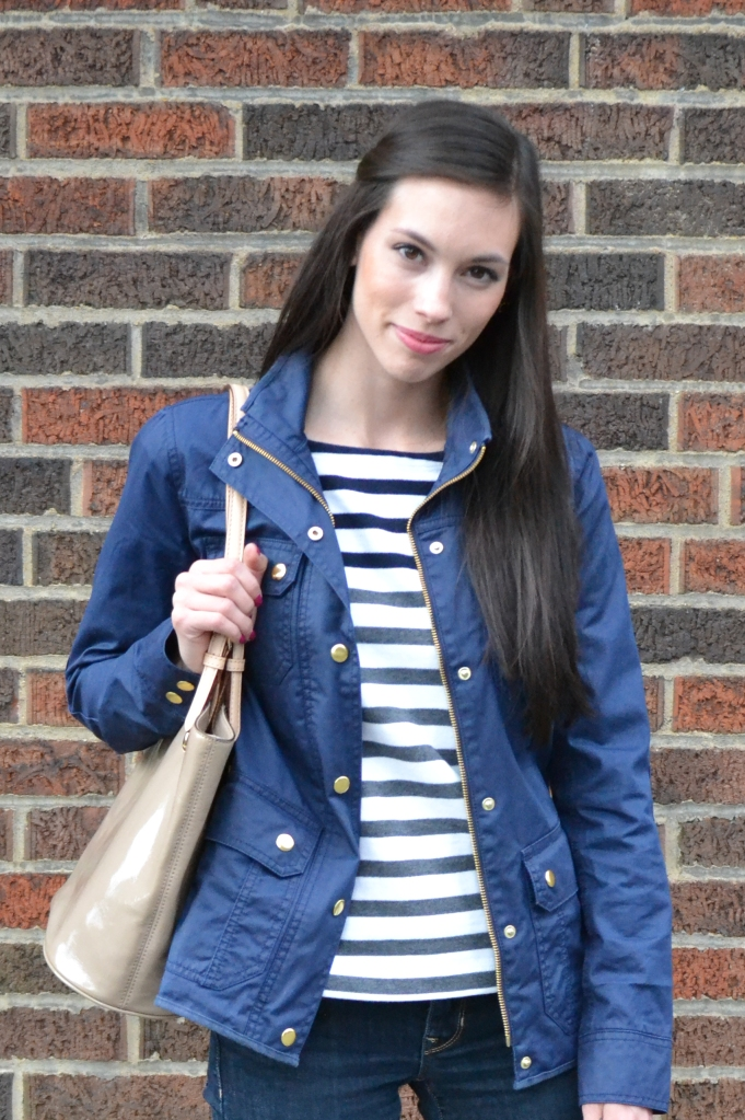 J Crew Downtown Field Jacket styled by top US fashion blog, Wellesley & King: image of a woman wearing a J Crew Downtown field jacket, GAP jeans, Michael Korrs bag, Target shoes and J Crew earrings.